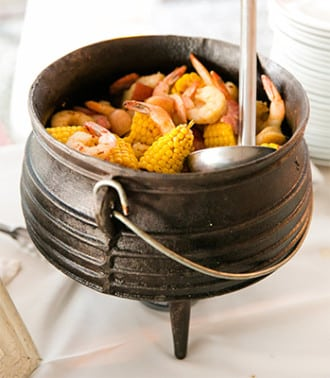 Lowcountry boil from the PPHG culinary team | Rehearsal dinner and welcome reception ideas from PPHG Events in Charleston, South Carolina | Photo by Dana Cubbage