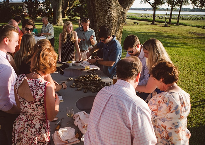 A Lowcountry Oyster Roast at The River House is a perfect welcome for friends & family | Cuisine by PPHG in Charleston, South Carolina | Photo by Amelia and Dan