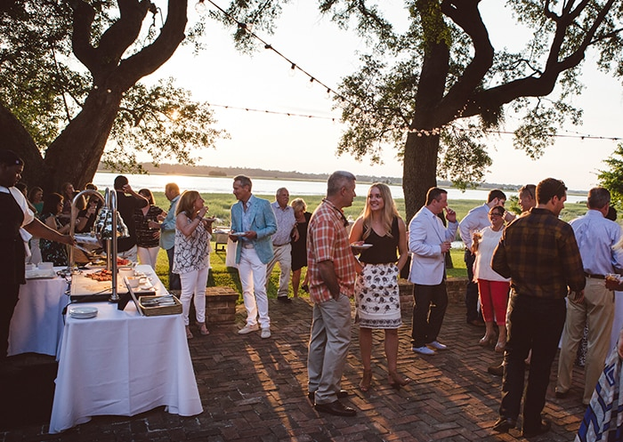 Lowcountry oyster roasts by PPHG Events are an authentic way to welcome wedding guests to Charleston, SC | The River House at Lowndes Grove Plantation | Cuisine by PPHG | Photo by Amelia and Dan