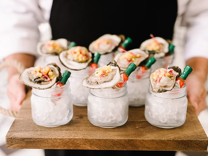 Oysters on the half shell from the PPHG culinary team | The River House at Lowndes Grove Plantation in Charleston, South Carolina | Rehearsal dinner and welcome reception inspiration | Photo by Rach Loves Troy Photo + Cinema