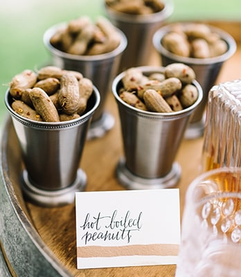 Boiled peanuts are a perfect Southern snack for an oyster roast welcome reception by PPHG Events | The River House at Lowndes Grove Plantation in Charleston, South Carolina | Photo by Rach Loves Troy Photo + Cinema