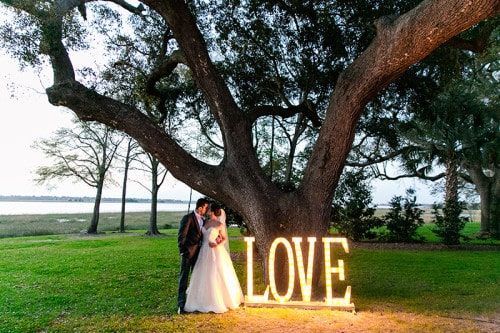 Gabby & Pedro's Lowndes Grove wedding reception on the banks of the Ashley River in Charleston, South Carolina | Photo by Dana Cubbage Weddings
