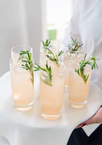 Specialty rosé cocktail with rosemary sprig from the PPHG team | Lowndes Grove Plantation in Charleston, South Carolina | Photo by Dana Cubbage Weddings