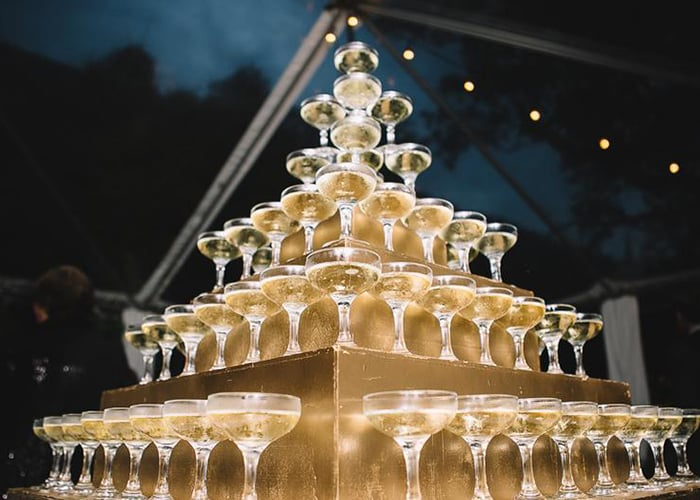 A champagne tower from PPHG events | Holiday event inspiration | Photo by Jennings King