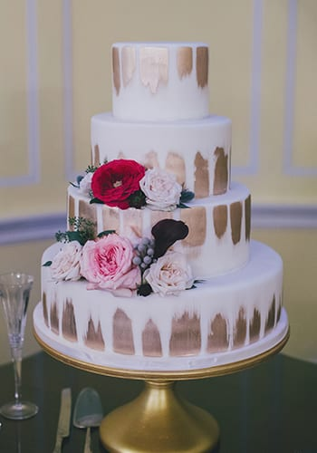Four tier custom wedding cake by PPHG pastry chef Jessica Grossman at Lowndes Grove Plantation in Charleston, South Carolina | Photo by Hyer Images