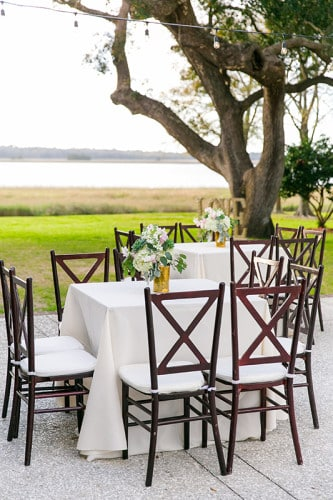 Riverfront wedding reception at Lowndes Grove Plantation in Charleston, South Carolina | Spring wedding inspiration | Photo by Dana Cubbage Weddings