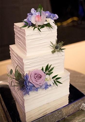 Three tier square wedding cake by PPHG pastry chef Jessica Grossman at The American Theater in Charleston, South Carolina