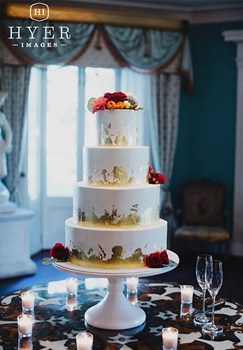Four tier wedding cake with gold foil leafs by PPHG pastry chef Jessica Grossman at The William Aiken House in Charleston, South Carolina