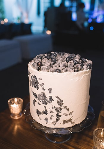 Wedding cake with frosted blueberries by PPHG pastry chef Jessica Grossman at Lowndes Grove